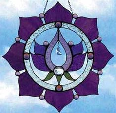 Google Image Result for http://www.beautifulstainedglass.com/content/images/thumbs/0011645_kamala_mandala_stained_glass_window_300.jpeg