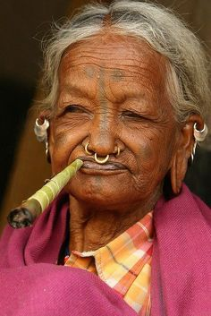Cool old lady with a fat spliff.