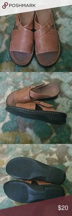 Tan/brown leather Clarks slides Very comfy and cute. In good condition. Clarks Shoes Sandals