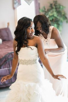 David's Bridal bride Raven in a strapless mermaid style White by Vera Wang wedding gown with jeweled belt and ruffled skirt.