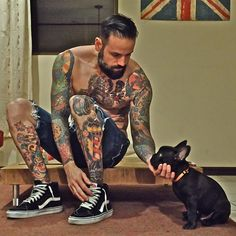 Tatted guy with a French Bulldog