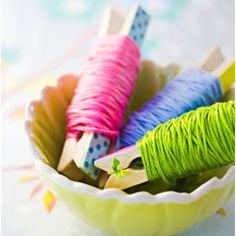 Wrap embroidery floss around clothes pins. Both pretty and practical.