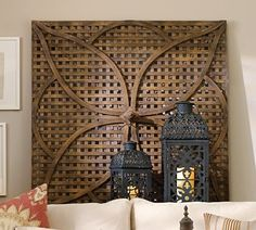 """A latticed panel from an English garden folly was the model for this weathered-wood wall art. It's crafted from mango and mahogany woods, with a metal finial at the center of the classic quatrefoil design."" Now, I'd rather have the original English garden folly panel... or a copy of it made of local wood. ""Mango and mahogany""? Oiled birch is better."