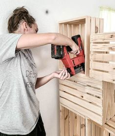 Are you living in a tiny apartment or house and need extra storage? Then this post is for you! Build your own DIY wood crate wall for just $100! #DIY #wall #crates