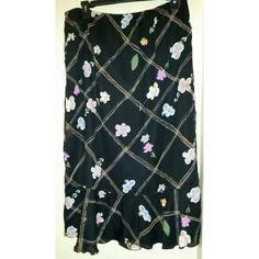 "Black Multi Color Floral Print Skirt Black Multi Color Floral Print Skirt -pre-owned but in good condition -Orchid Rose -size 2X -elastic waist; lined -approx. 18"" waist -approx. 33"" length Orchid Rose Skirts"
