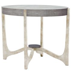 The sculptural shape of this coffee or side table is complemented by the oval, faux-shagreen top, a detail that is thoughtfully and decoratively repeated on the base. Evoking a late vibe, the Dexter has a top that appears to float and a finished look Mod Living Room, Silver Candelabra, Coffee Table Grey, Beach Design, Made Goods, Dexter, Modern Lighting, Cool Things To Make, End Tables