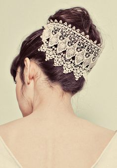 A beautiful up-do with an ivory lace headpiece