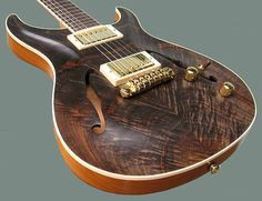 Here is an interesting Giffin guitar - the maker of the Vitka.  Hollow-body Standard, Walnut top  http://www.giffinguitars.com/index.htm#