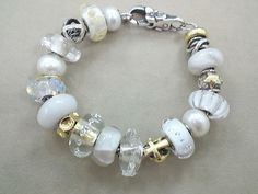 Trollbeads white  / clear / gold