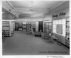 """Chintz Shop at The J.L. Hudson Company Department Store. Bolts of differing styles of floral-patterned fabric are displayed throughout the retail area. Signage in the right foreground of the image reads, """"Hudson's and Better Homes and Gardens Say, 'Slip Cover for Cool Summer Living,'"""