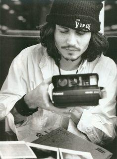 {Depp and a Polaroid} a Spectra polaroid! cool.