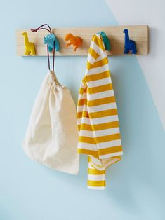 Children can hang their belongings on these really cute pegs! A wooden coat rack with 5 dinosaur-shaped pegs: decorate your child's room in lovely colours and he will be proud to hang up his coats and bags! DIMENSIONS: 55 x 10 cm <br Dinosaur Kids Room, Dinosaur Room Decor, Dinosaur Bedroom, Die Dinos Baby, Wooden Coat Rack, Bedroom Accessories, Baby Boy Rooms, Girl Room, Child's Room