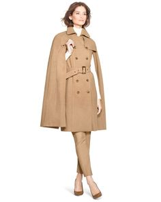 Part cape, part coat, pure sophistication. Finished with trench-inspired detailing, cinch the waist with the accompanying belt to balance the proportions.    Trench coat with cape   Double-breasted button front; side seam pockets    Viscose/polyester/spandex. Machine wash, cold.   Fully lined    Approx. 38