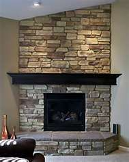 I want to retile the woodstove hearth  This type of stone is what I hadGrey stone fireplace with floating mantle electric fireplace  . Stone Fireplace Hearths. Home Design Ideas