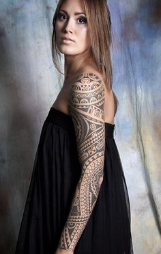 Polynesian inspired sleeve tattoo. The tattoo is very fun to look at and the more that you stare at the designs the more drawn in you will be. It's one of those tattoos that grow on you..