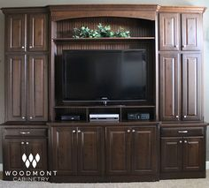 Tacoma Knotty Alder  Entertainment Center By Woodmont Cabinetry