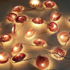 Have a lot of seashells collected from last year's beach trip? Attach them to string lights. #summerlights