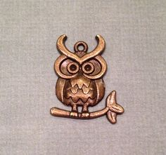 This auction is for twenty cute antique bronze owl charms. The charms measure 13mm x 12mm x 1.5mm.  @http://tophatter.com/auctions/14579