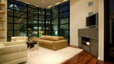 floor-to-ceiling-framed-window-with-a-corner-and-tv-fireplace-352x198.jpg