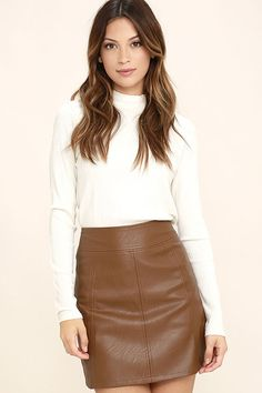 You'll get nothing but adoration in the Applause Brown Vegan Leather Mini Skirt! Sleek vegan leather is formed to this body-skimming skirt with seamed detail. Exposed antique gold back zipper.