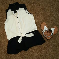 Top This cute top falls at the waist a is button down with a tie at the bottom.  A little on the shear side looks cute with a bando top underneath. It's a Forever 21 brand size large Forever 21 Tops Button Down Shirts