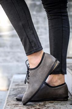 """Unique winter flats, with an almond shape toe. These modern oxfords have a minimalistic design, and are made of soft elephant grey leather and a black """"collar"""" for a chic twist on the classic tie shoes. The clean lines are flattering and the stacked heels are super comfortable. Great leather shoes for running around the city, day to night. Ankle Height (7 cm / 2.75'') . Chic Elephant Grey Flats. Made of 100% Genuine Leather. Comfortable Stacked Heel (1.5 cm / 0.6'') . Lace Closure . Neolite…"""