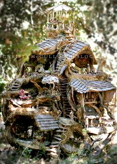 Fairy house...We've made some really sweet ones by embellishing bird houses from the local craft store...This one is a bit more elaborate... To make your own, collect small rocks, acorns, moss, pieces of bark, and other little items to decorate with...