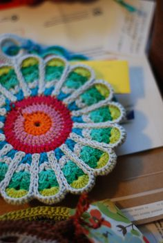 Colorful Flower Potholders... These look like they're part of a mosaic picture. The changing vibrant colors really give this floral design some flair. The pattern can be found here: http://olavas.blogspot.com/2009/08/oppskrift-pa-fargesterk-grytelapp.html