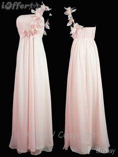Blush pink maxi dress with one-shoulder flower embellishment.