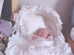 Sydney sleeping in the bassinet set I made when Dalton was born.