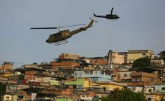 Amongst helicopters, soldier and police, the Socceroos arrived in Brazil. But when and why did the World Cup come to mean that such 'high-level' security is needed? It's supposed to be a celebration. 30.05.14