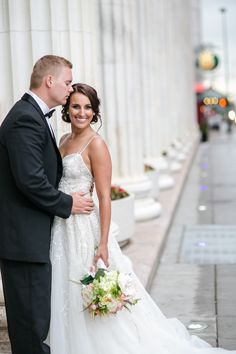 downtown Denver, LoDo, Curtis Park, Colorado wedding, wedding location ideas, black tie wedding style, street romantic pose, historical wedding locations, urban, city chic stylish modern photographer. Katie Corinne Photography.  Lazaro spaghetti strap, sparkling skirt, low back wedding gown is gorgeous