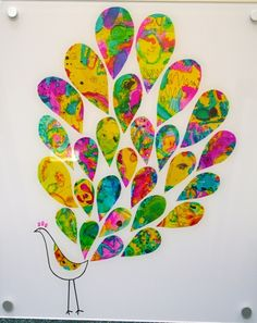 "Each kiddo could paint a large paper with bright colors then cut the ""feathers"" and create their own peacock."