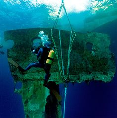 The 100th Anniversary of the Sinking of Titanic: A 17-ton portion of the hull of the RMS Titanic is lifted to the surface during an expedition in 1998. The piece along with 5,000 other artifacts will be auctioned as a single collection on April 11, 2012, 100 years after the sinking of the ship. (RMS Titanic, Inc./Associated Press)