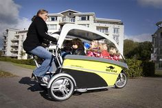 GoCab bicycle taxi for children -- electric power assist for pedalling and can carry eight children safely.