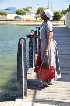 grey coat with burgundy skirt, grey stiletto pumps and ankara tote handbag.