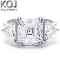This is a  sleek and elegant diamond engagement ring. Its focal point is the 3.01 carat asscher cut diamond. This beautiful diamond has a clarity of Vvs2 and a color grade of G. On each side are sparkling trillion cut diamonds. These beautiful diamonds have a total combined weight of 1.25 carats. These diamonds range in clarity from Vvs1-Vvs2 with a color grade of G. The gorgeous setting is made of 14kt white or yellow gold or 18kt white or yellow gold or platinum with a total diamond weight…