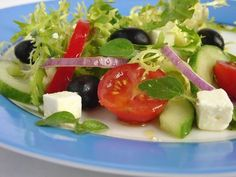 This is the most delicious salad - fresh and wonderful-tasting.  FYI, lettuce can very much be a part of any greek salad - if you want it to.  We like lettuce in my family and I often add it.  It would not be authentic in a Horiatiki (village) salad, but who cares?