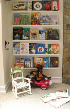 Children's reading nook - great idea, turn books front facing :)