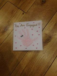 You're Engaged!! Childs hand print card for newly engaged couple.