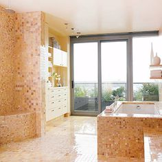 A tile shower wall that includes the tub in a room with a window...perfect !