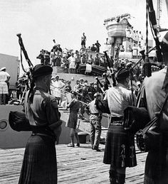 Bagpipers of the Argyll and Sutherland Highlanders on August 29, 1950, pipe ashore at Pusan a battalion of their Scottish regiment and a battalion of the English Middlesex Regiment; the first allied ground forces to join the Americans and South Koreans. (U.S. Army photo.)