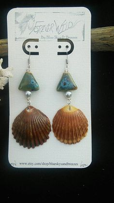 Check out this item in my Etsy shop https://www.etsy.com/listing/212084638/shell-earrings-with-beautiful-bead