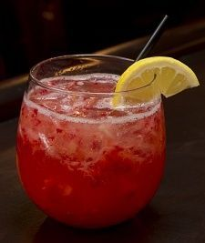 Redhead in Bed - citron vodka muddled strawberries sparkling wine lemonjuice.