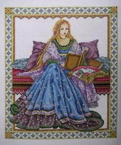 The Reader - Joan A. Elliott  I loved cross stitching this one, there are lots of beads and Kreinik thread for sparkle.  The picture definitely doesn't do it justice.