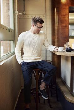 handsome male model wearing a white woollen sweater and loose pants