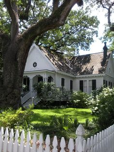 The perfect white country cottage with white picket fence.