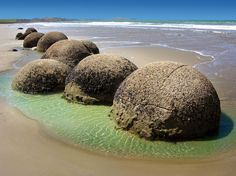 MOERAKI BOULDERS, NEW ZEALAND The giant spherical boulders are sediment concretions formed over a gradual process of 60 million years! These stones can be found on the Koekohe Beach near the Otago coast.