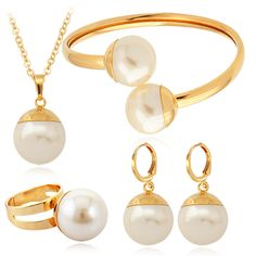 18k gold plated pearl jewelry set; bracelet, pendant necklace, ring, earrings.   Most shining jewelry set.   Would like to own one set? Ebay item no: 201161241347