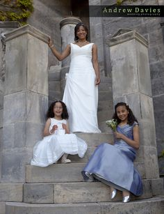 wedding dress white and blue / grey bridesmaid dress photo by wedding photographers www.andrew-davies.com
